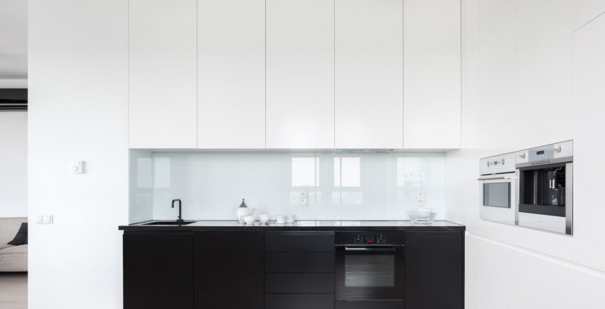 Elegant and simple kitchen with black and white cupboards